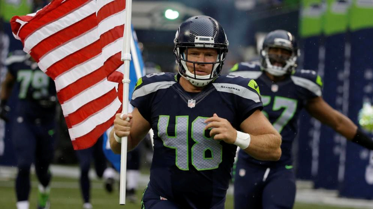Seahawks running with US Flag